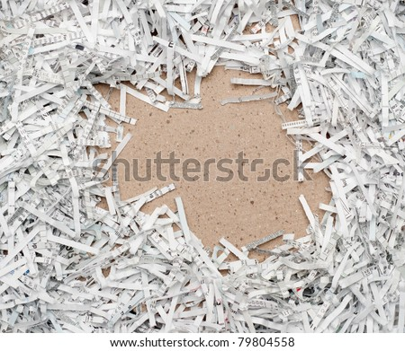 Shredded white paper with recycled brown paper copy space - stock photo
