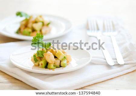 Shrimp and Avocado on White Plate - stock photo
