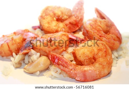 Shrimp and rice dish in restaurant - stock photo