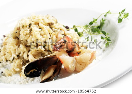 Shrimp and Scallop Risotto Served with Green. Isolated on White Background - stock photo