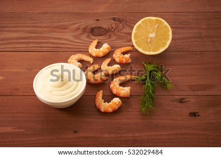 shrimp and spices on a wooden board
