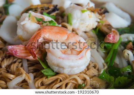 Shrimp and squid, Vegetables with noodles - stock photo