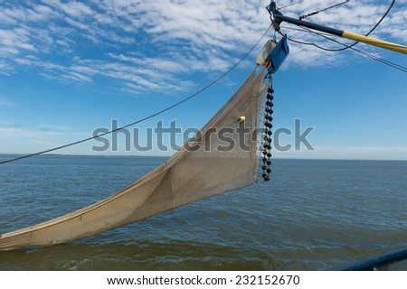 shrimp fishing boat ready to drop the net into the water of the sea