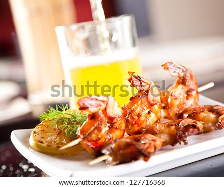 Shrimp grilled with beer - stock photo