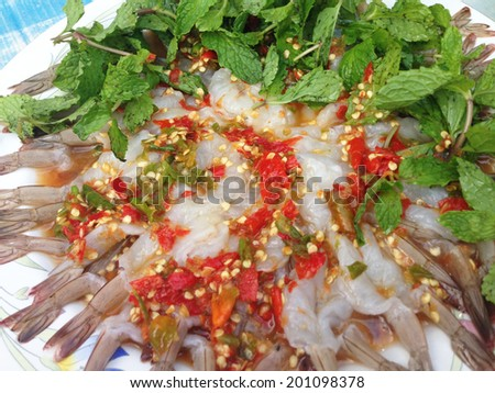 Shrimp in spicy seafood sauce - stock photo