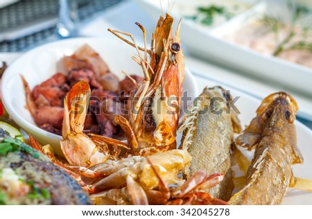 Shrimp on the plate with seafood - stock photo