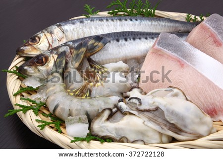 shrimp,oyster,yellow tail fish and sardine/seafood - stock photo
