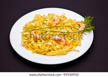 Shrimp pasta dish - stock photo