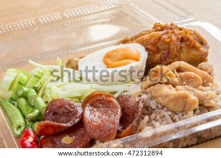 Shrimp-paste fried rice with chinese sausage, fried chicken salted egg and vegetable, Thai food
