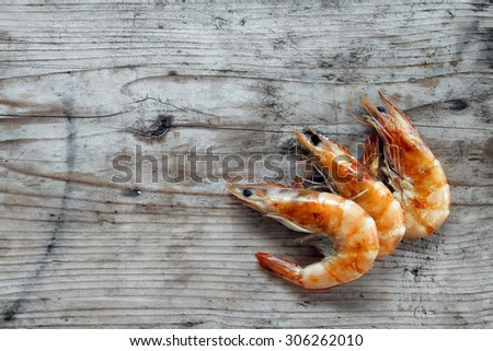 shrimp - prepared fresh seafood scampi on natural organic rustic wooden background - stock photo