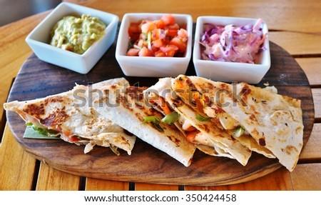 Shrimp quesadillas with guacamole and pico de gallo - stock photo