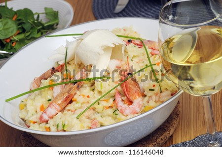 Shrimp risotto with white wine - stock photo