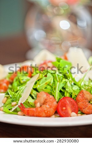 shrimp salad with cheese and arugula