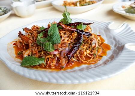 Shrimp salad with lemon grass and mint. - stock photo