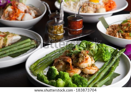 Shrimp scampi seafood dish with broccoli and asparagus. - stock photo