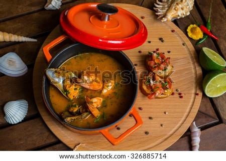 Shrimp soup in a saucepan  - stock photo