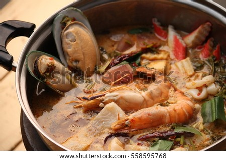 Shrimp soup pot on table in Thailand.