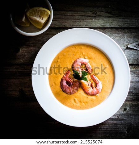 Shrimp soup with mussels on rustic background - stock photo
