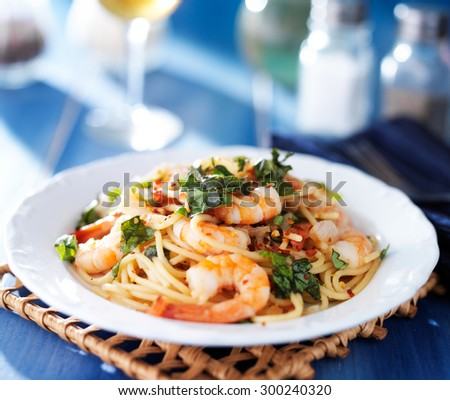 shrimp spaghetti pasta with fresh basil and crushed red pepper - stock photo