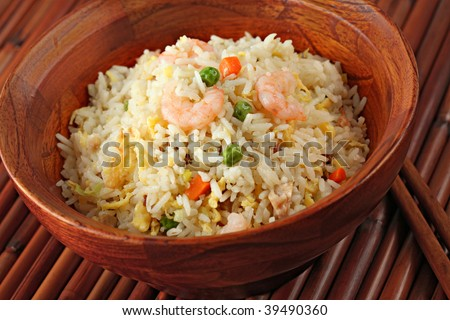 Shrimp Stir Fried Rice in a Bamboo Bowl - stock photo