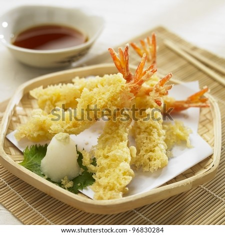 Shrimp Tempura. Japanese deep friend shrimp in the bamboo with dipping souse. - stock photo