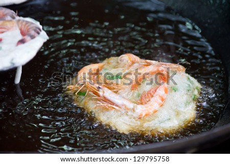 shrimp toasts frying in oil on the pan - stock photo