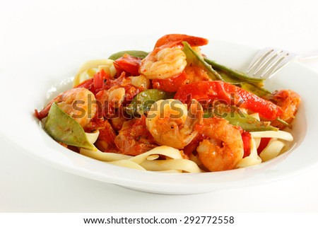Shrimp, tomato, red pepper and snow pea with fettuccine   - stock photo