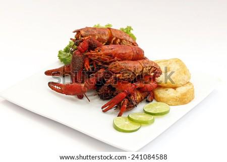Shrimp with Fresh Salad BBQ (Peruvian dish) - stock photo