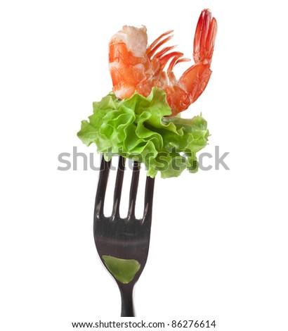 shrimp with fresh salad lettuce on fork isolated on white - stock photo