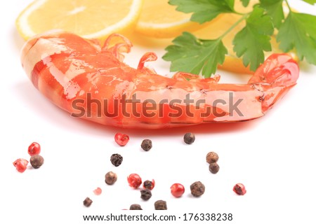 Shrimp with lemon and red pepper. On a white background.