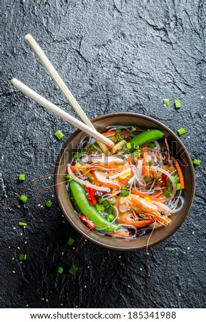 Shrimp with noodles and vegetables - stock photo