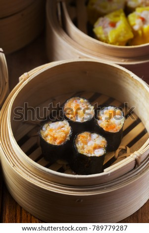 shrimp wraped with seaweed dumpling in bamboo contrainer