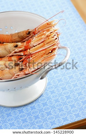 Shrimps in colander elevated view - stock photo
