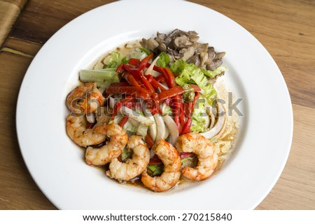 Shrimps, peppers and mushrroms fresh salad - stock photo