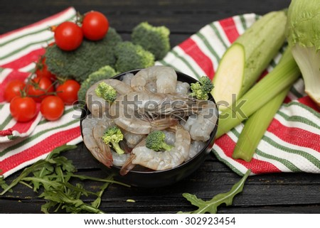 Shrimps. The process of preparing seafood with vegetables. - stock photo