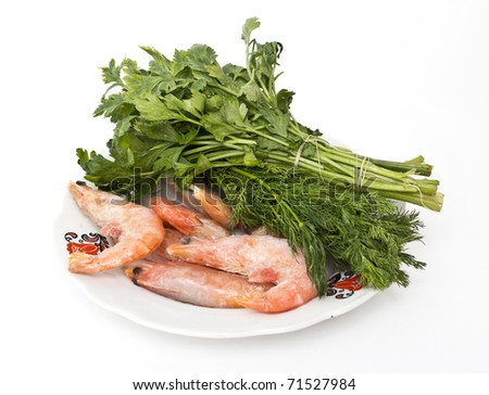 shrimps with dill on white plate