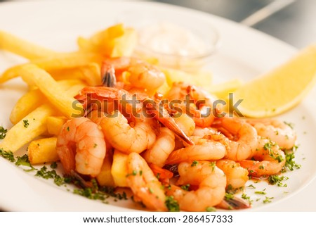 shrimps with french fries potatoes