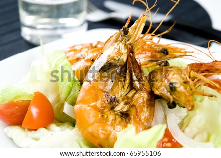 Shrimps with fresh vegetables - stock photo