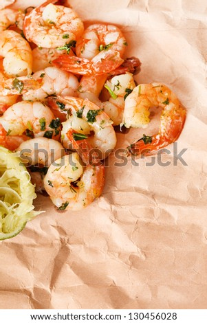 shrimps with lime and parsley - stock photo