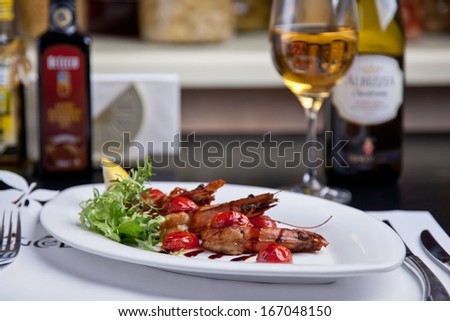 Shrimps with sauce and cherry tomatoes