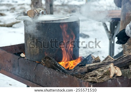 shurpa - soup with meat and potato on the fire - stock photo