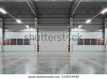 Shutter door inside factory, night scene. - stock photo
