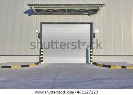 Shutter door or rolling door beige color in new factory construction site & Shutter Door Rolling Door Beige Color Stock Photo 461127223 ...