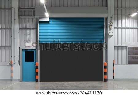 Shutter door or rolling door blue color, night scene. - stock photo