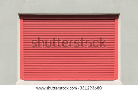 Shutter door or rolling door, red color. - stock photo