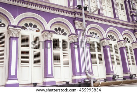 shuttered windows building front in Chinatown of Singapore city