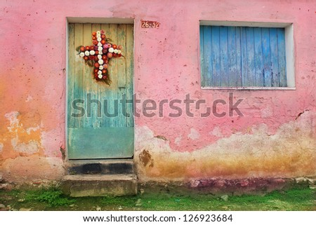Shuttered Wooden Window and Doors in Guatemala City, Decorated With Flower Wreath - stock photo