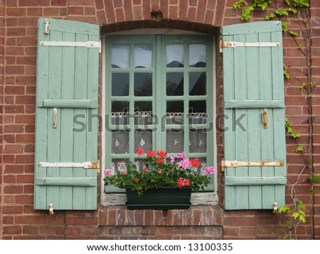Shutters on pretty window