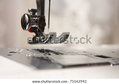 Shuttle a needle. Part of the sewing machine close-up - stock photo