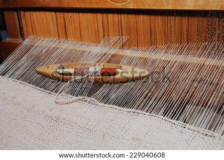 shuttle on the antique loom and thread - stock photo